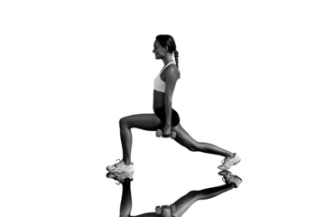 Composite image of fit woman doing weighted lunges on the beach