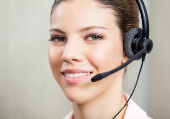 Closeup Of Customer Service Agent Wearing Headset