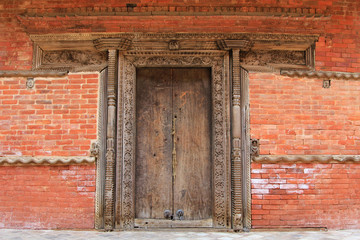 Crafted wooden doorframe and wall decoration in Kathmandu