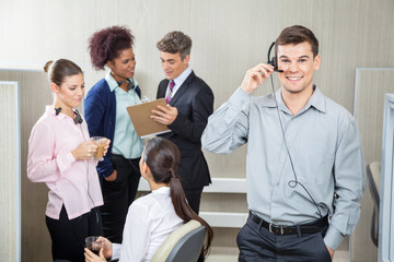 Happy Male Customer Service Representative Using Headphones