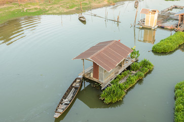 Floating wooden house in Thailand