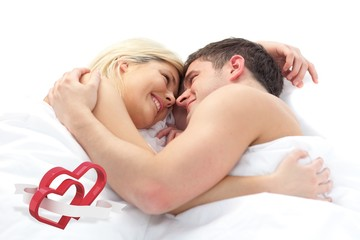 Composite image of loving couple relaxing on bed