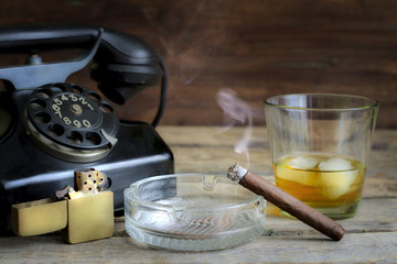 Cigar and whiskey abstract retro still life with telephone