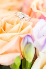 diamond ring on rose