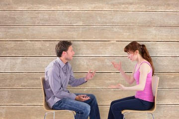 Composite image of sitting couple having an argument