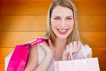 Smiling blonde woman holding shopping bags