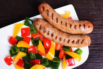 Grilled sausages with easy side dish of peppers, yellow, green