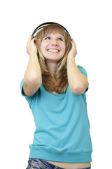 Woman listening to the music using big headphones on white.