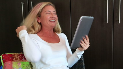 Smiling woman using tablet PC