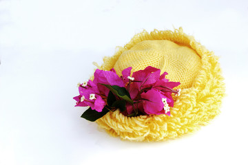 yellow hat and paper flower on white bg