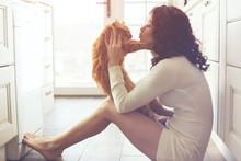 """Постер, картина, фотообои """"Girl playing with cat"""""""
