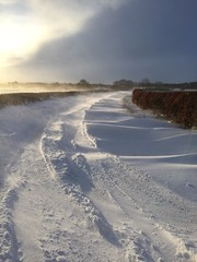 Rural road block snow drift winter storm Northumberland England
