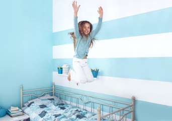 Kid girl jumping on bed