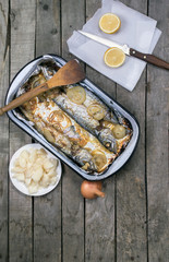 baked mackerel fish with onion lemon and potato salad