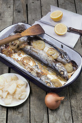 mackerel fish in casserole with onion lemon and potato salad