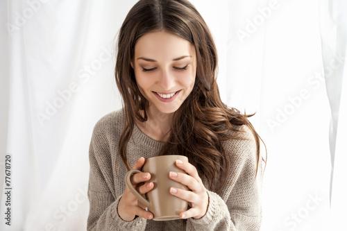 beautiful woman enjoying coffee in the morning