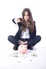 Beautiful business girl with piggy bank