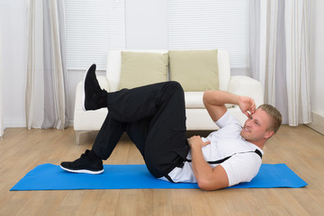 Happy Healthy Young Man Exercising