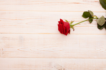 Red rose on wooden background, Valentines Day. Top view