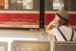 Leinwanddruck Bild - Girl waiting for the train at the railway station. Travel..