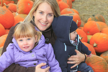 An attractive Mother with kids Portrait in Pumpkin
