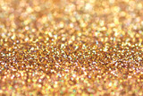 Gold nuggets sparkling carpet. Close-up view, very shallow deep