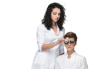 Optometrist examines the sight of young girl
