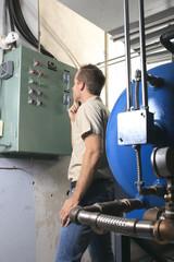 A Air Conditioner Repair Man at work