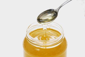 cucchiaino del vaso di miele