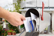 Man Taking Letter From Mailbox
