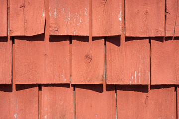 Old curling painted wood shingles with shadows