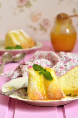 Piece of curd casserole (pudding) with honey dressing.