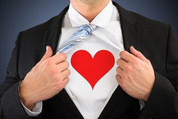 Businessman Pulling His Shirt Showing Heart Shape Symbol