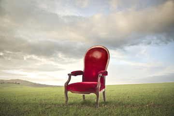 Red chair in a meadow