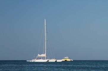 White trimaran in blue sea