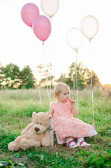 baby with candy and balloons