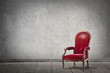 Red chair in an empty room - 77687154