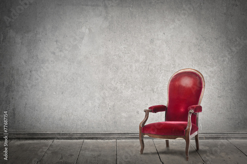 Red chair in an empty room