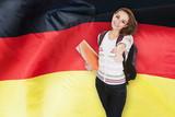 Fototapety German Student Gesturing Thumb Up