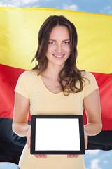 German Woman Holding Digital Tablet