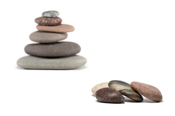 Pebbles and Cairn with Focus on Foreground