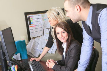 Image of business partners discussing documents and ideas at