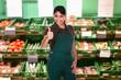 Female Sales Clerk Showing Thumb Up Gesture