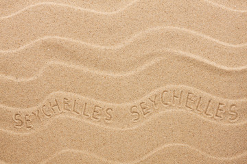 Seychelles  inscription on the wavy sand