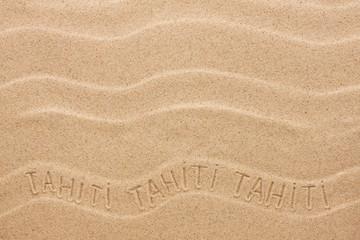 Tahiti  inscription on the wavy sand