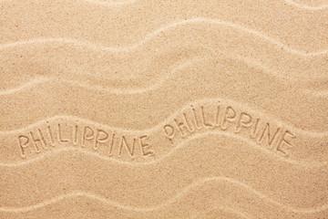 Philippines  inscription on the wavy sand