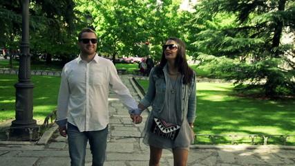 Couple in love walking in beautiful city park