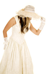 woman in a white dress and hat and gloves side look down