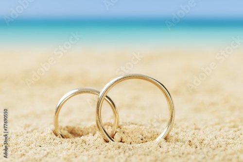 Wedding Rings On Sand - 77690550