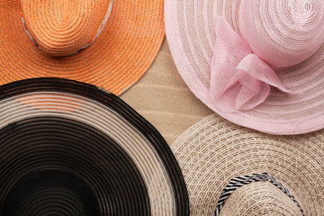 Four  hat lying on the undulating sand